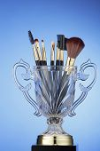 brushes in the trophy on the blue background