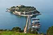KUSADASI, TURKEY - APRIL 7, 2014: View to the castle on Pigeon island. Built in Byzantine Era, now t