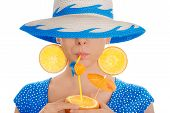 Girl with Orange Drink and Orange Slice Earrings Wearing Hat White Background
