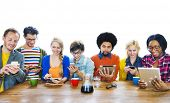 stock photo of time study  - Group of Multiethnic People using tablet Devices - JPG