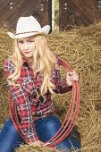 Sensual Passionate Caucasian Cowgirl With Lasso Rope In Farm
