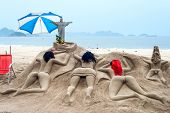 Sand sculpture sunbathe on the beach of Copacabana