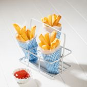 Cones of fries with tomato ketchup