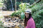 Asia Woman With Mon Tha Than Waterfall In Doi Suthep - Pui National Park, Chiang Mai  Thailand