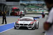 SEPANG, MALAYSIA - MAY 10, 2014: The BMW car of drivers Jun San Chen and Ollie Millroy returns to th