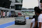 SEPANG, MALAYSIA - MAY 10, 2014: The official Safety Car enters the pit lane at the end of the free