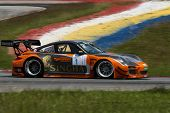 SEPANG, MALAYSIA - MAY 10, 2014:The Porsche 997 car of Vutthikorn Inthraphuvasak takes to the track at the Thailand Supercar GT3 race of the Thailand Super Series Rd 1 in Sepang International Circuit.