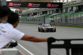 SEPANG, MALAYSIA - MAY 10, 2014: The BMW car of Morris Chen and Tatsuya Tanigawa races down the stra