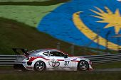 SEPANG, MALAYSIA - MAY 10, 2014: The Toyota 86 car of Manat Kulapalanont takes to the track at the T