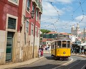 LISBON, PORTUGAL - APRIL 18, 2014: Very touristic place in the old part of Lisbon, with a traditiona