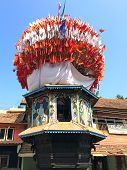 picture of chariot  - Wooden chariots with flags and paintings of hindu gods in Gokarna Karnataka India - JPG