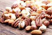 foto of mixed nut  - Background texture of assorted mixed nuts including cashew nuts, pecan nuts, almonds
