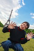 Smiling Boy In Front Of The Eiffel Tower (la Tour Eiffel) In Paris