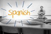 The word spanish against lecturer sitting in lecture hall