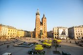 KRAKOW, POLAND - FEB 26, 2014: View of the Main Square. It dates to the 13th century, and at roughly 40,000 m it is the largest medieval town square in Europe.