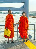 Two Teenage Monks Wait For The Ferry In Bangkok