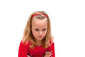 stock photo of saddening  - beautiful girl is upset and saddened scowls down - JPG
