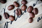 Fresh coffee beans on wooden background, selective focus