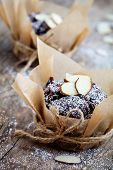 Fresh homemade chocolate muffins with sliced almonds