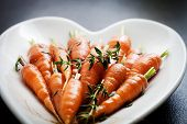 Close up of carrots with fresh thyme