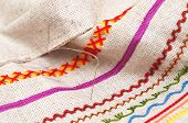 stock photo of thread-making  - needle with thread on fabric with embroidery close - JPG