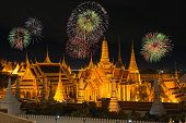 Grand Palace And Wat Phra Keaw In Night With New Year Fireworks