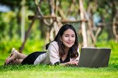 Young Pretty Asia Woman With Laptop Typing