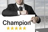 Businessman Pointing On Sign Champion