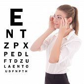 Young Beautiful Business Woman In Glasses And Eye Test Chart Isolated On White