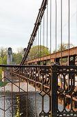 old rusty steel suspension bridge