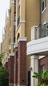 Stucco Balconies Over Brick Columns