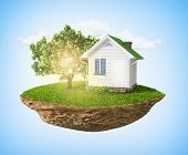 image of levitation  - Beautiful small island with grass and tree and house levitating in the sky - JPG