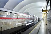 Russia, St. Petersburg, Metro Station Train Departs From Subway Platform.