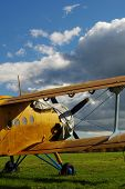 stock photo of biplane  - Sporting biplane aircraft prepared on the tarmac - JPG