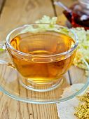 picture of meadowsweet  - Meadowsweet tea from a glass cup and teapot - JPG