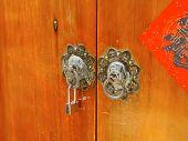 Ancient knockers and modern lock closeup