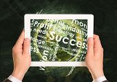 Man hands using tablet pc. Earth and business words on touch screen