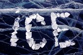 Word ice made from ice on winter frozen lake Baikal