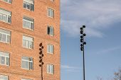 picture of light-pole  - A light pole casts a shadow on an apartment building - JPG