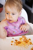 Baby Eating Tomato Meal With Her Hand