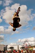 Man Flips Upside Down Performing Bmx Stunt At Fair