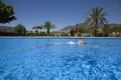 Woman Lying On Water Pool