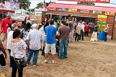 People Wait In Long Line To Buy Food At Fair