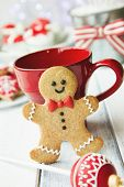 stock photo of gingerbread man  - Gingerbread man and red mug - JPG