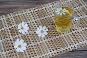 picture of chamomile  - chamomile and chamomile tea on a wooden table - JPG