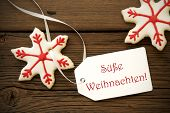 picture of weihnachten  - The German Words Suesse Weihnachten which means Sweet Christmas on a Label with Christmas Cookies - JPG