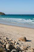 Sennen Cove Beach With Longships Lighthouse On The Horizon, Cornwall, Uk
