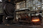 The Heated Steel Pigs On The Industrial Metal Press