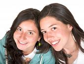 stock photo of sissy  - beautiful sisters portrait over white - JPG