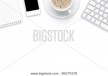 Office desk table with computer, supplies and coffee cup. Isolated on white background. Top view wit